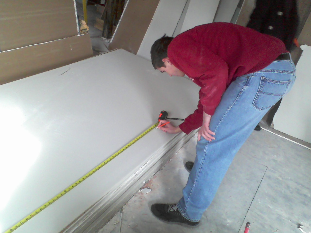 Measuring out sheetrock at Miss Anne's house.