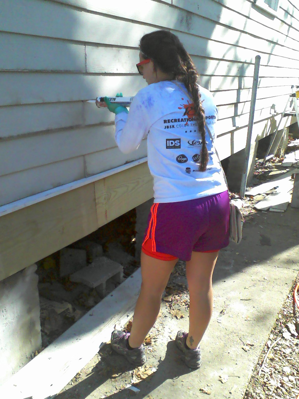 Wielding a mean caulk gun.