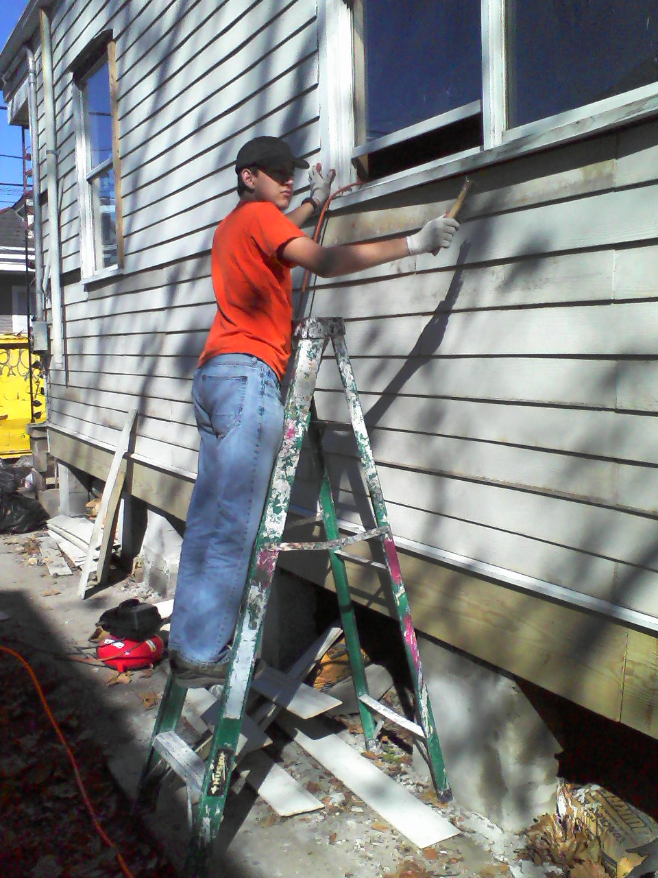 Working on siding at South Salcedo in warmer times.