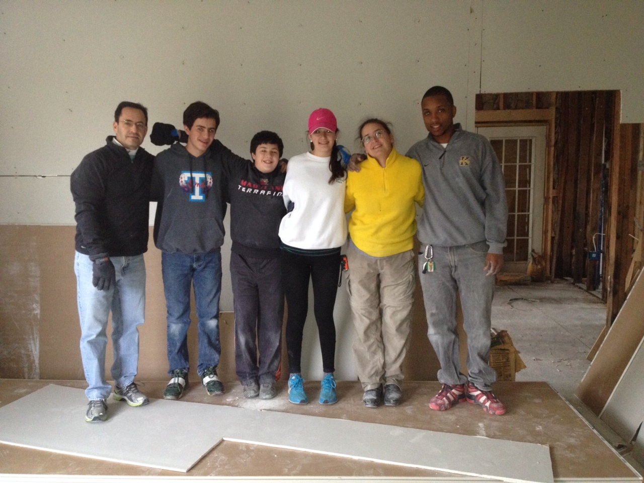 The Selati family helped Anne Baker and Prince with some sheetrocking at Alvar.