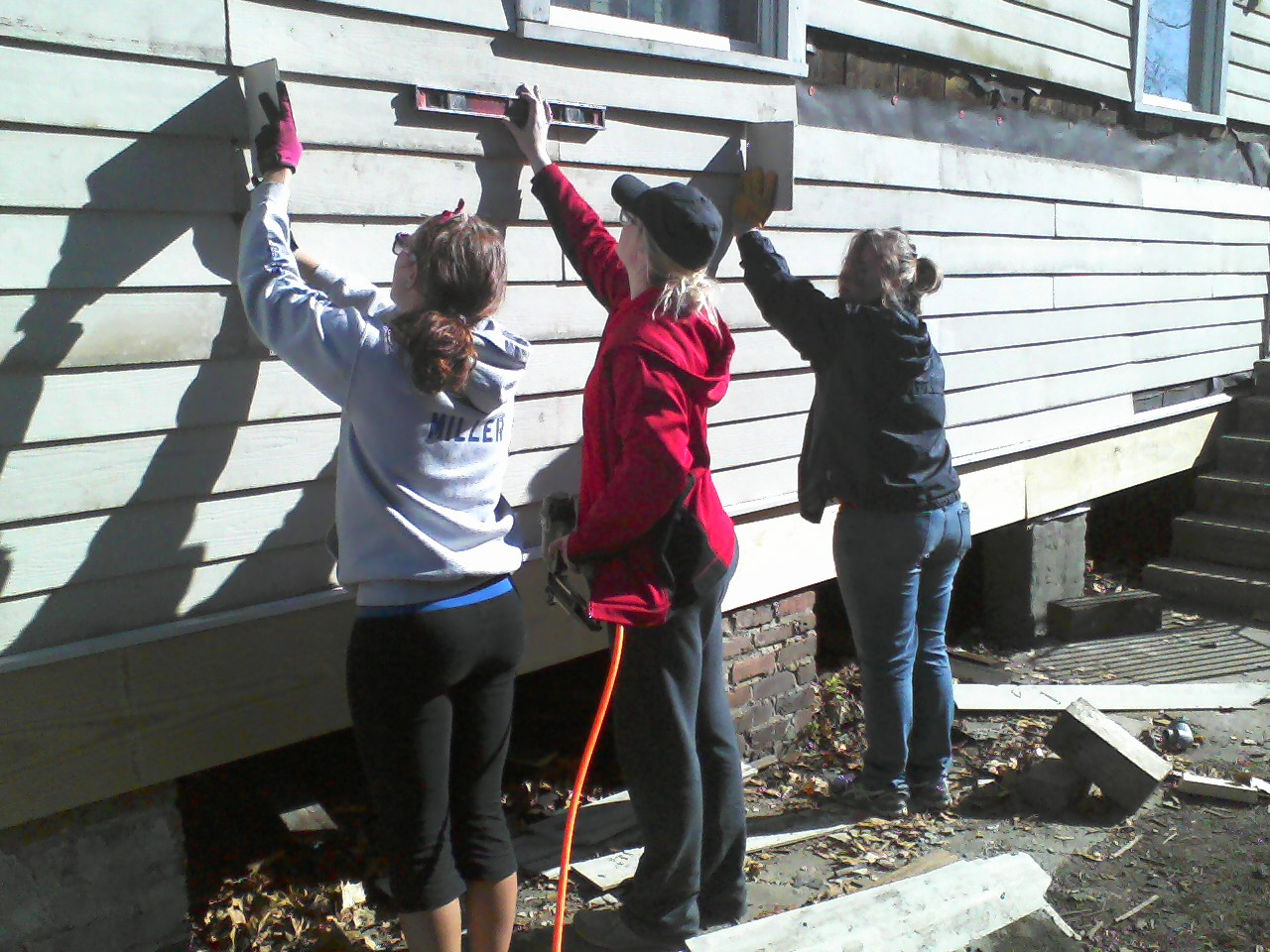 ...and installing siding.