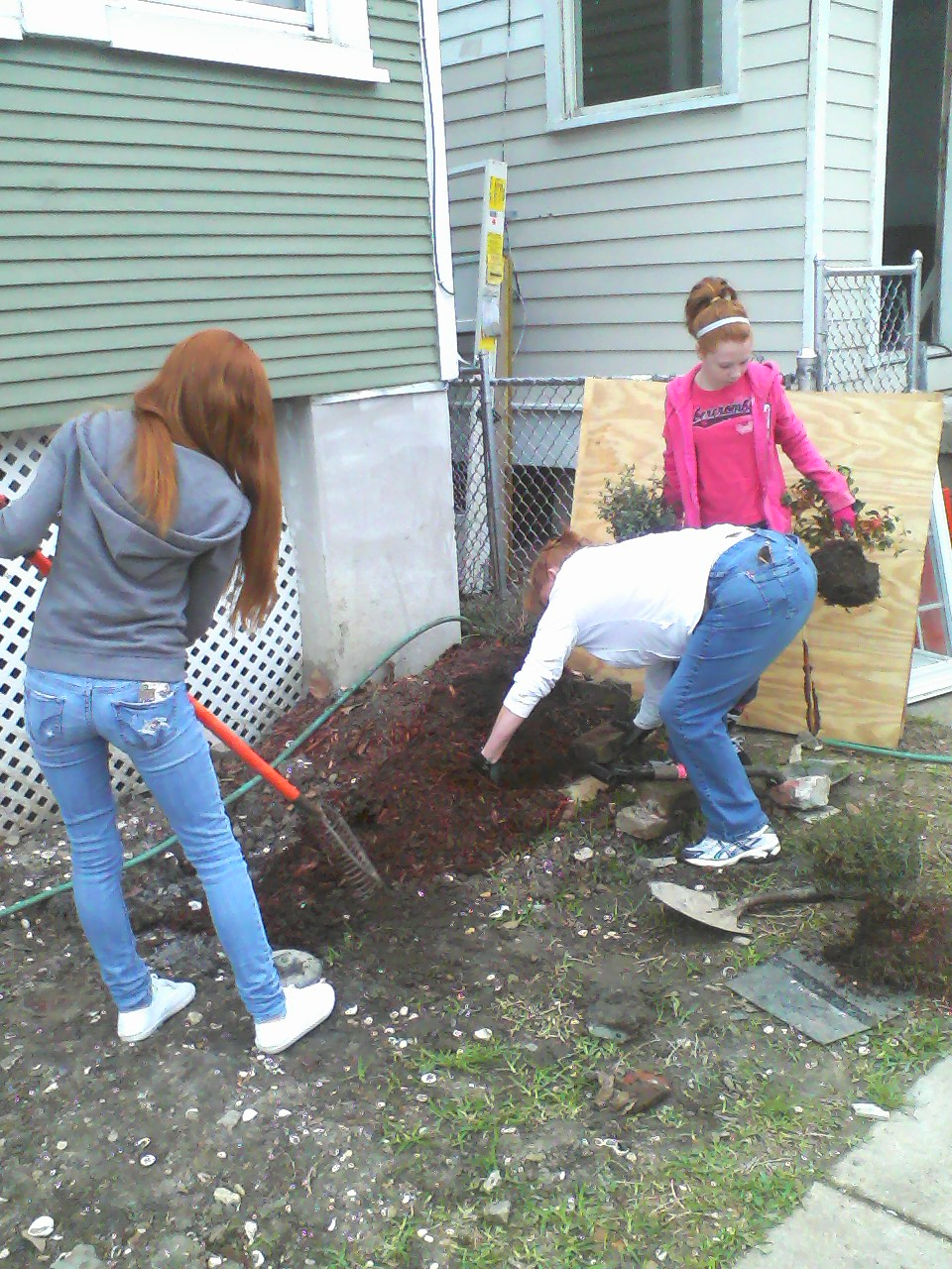 The Brooks family helps with garden repair at South Salcedo.