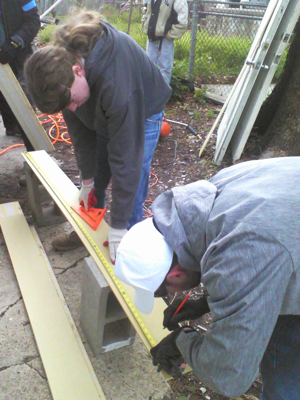 Measuring out the new siding.