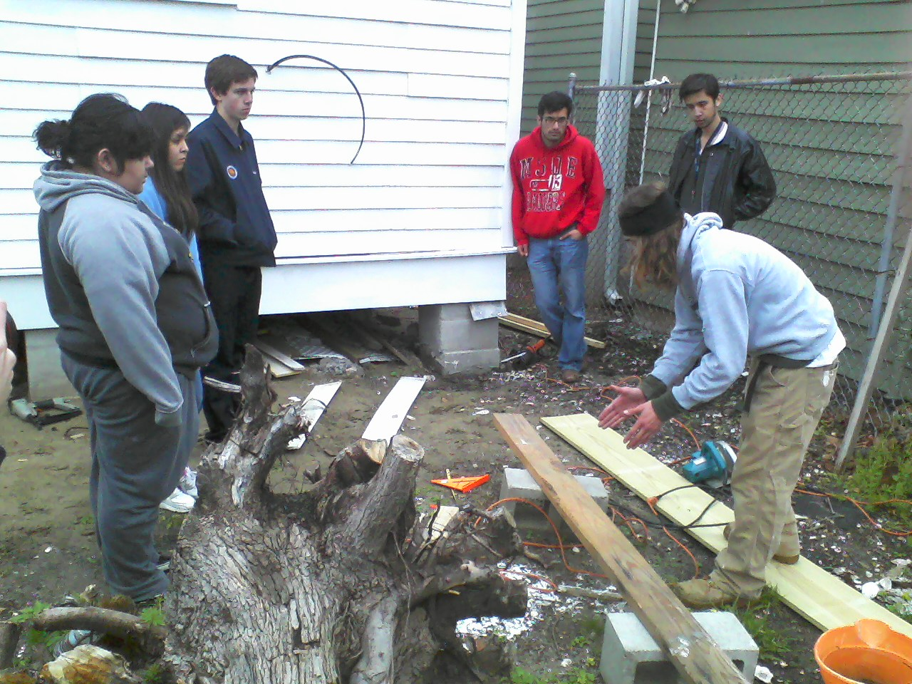 Ryan shows the finer points of wood cutting.