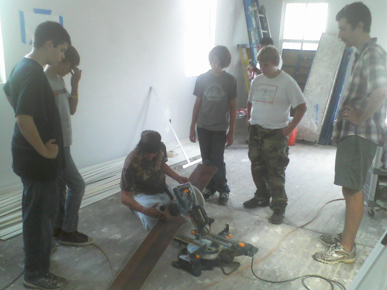 Ryan demonstrates his carpentry skills to the Salcedo crew.