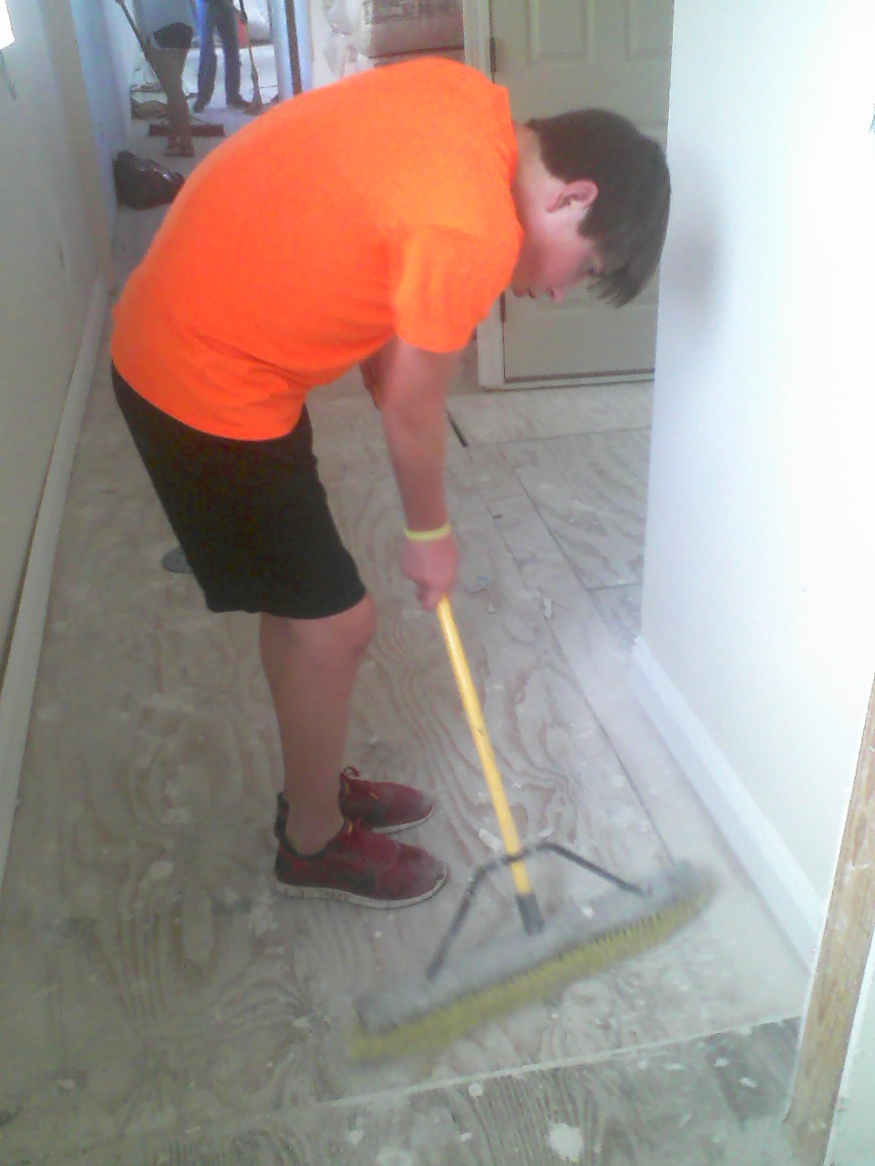 Sweeping it up.