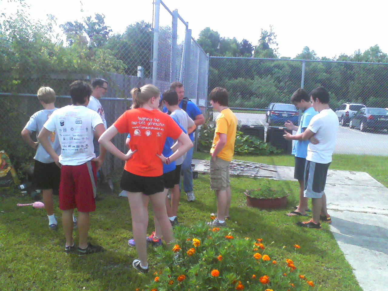 Mr. Willie huddles up the garden group.