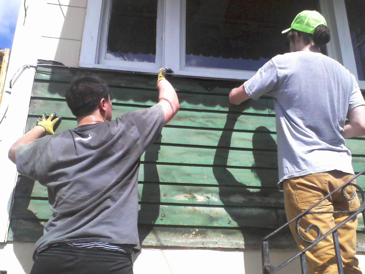Shawn and Griff remove old siding.