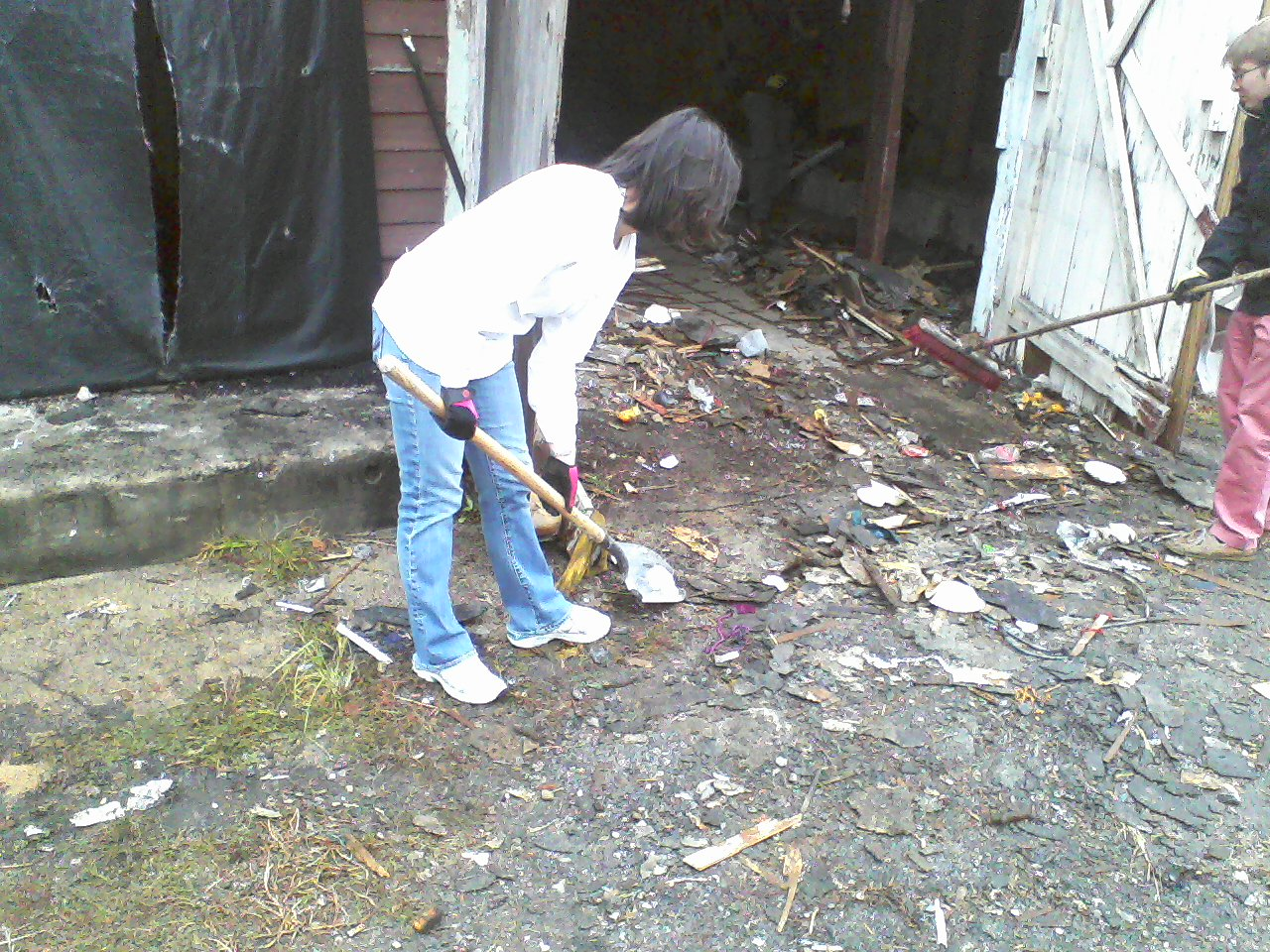 Jenni scoops up debris.
