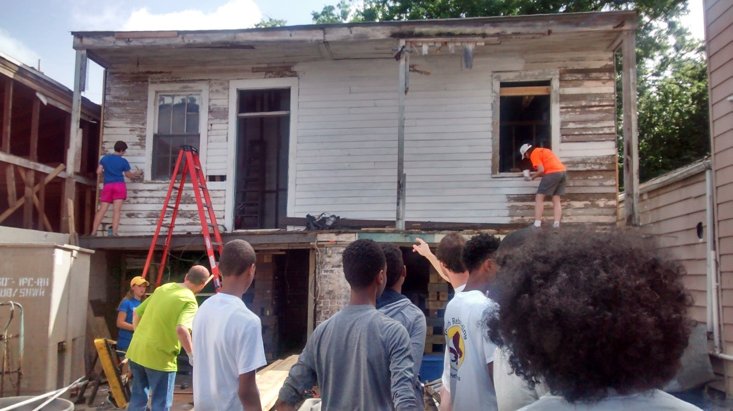 Our youth crew sees how priming gets done with Catholic Mission Trips.