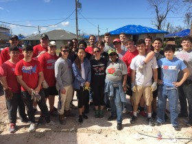 Rummel and Sci Academy Volunteers with Homeowner, Ms. Linda