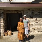 SALT Travel participants working with a homeowner in New Orleans East whose home was severely damaged by the February tornado